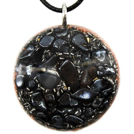 Orgonite, crystal, hematite, energy, emissions protection, pendant, copper background